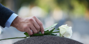 Flower Being Placed on Casket